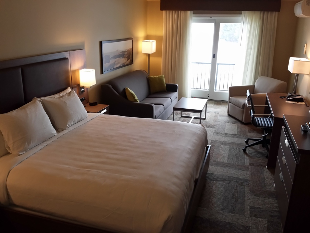 King room mini-suite includes desk and flatscreen TV and sliding door to access balcony