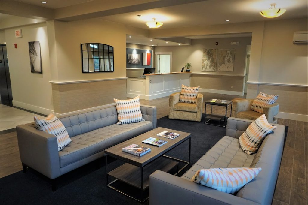 The lobby includes chairs and couches near the front desk