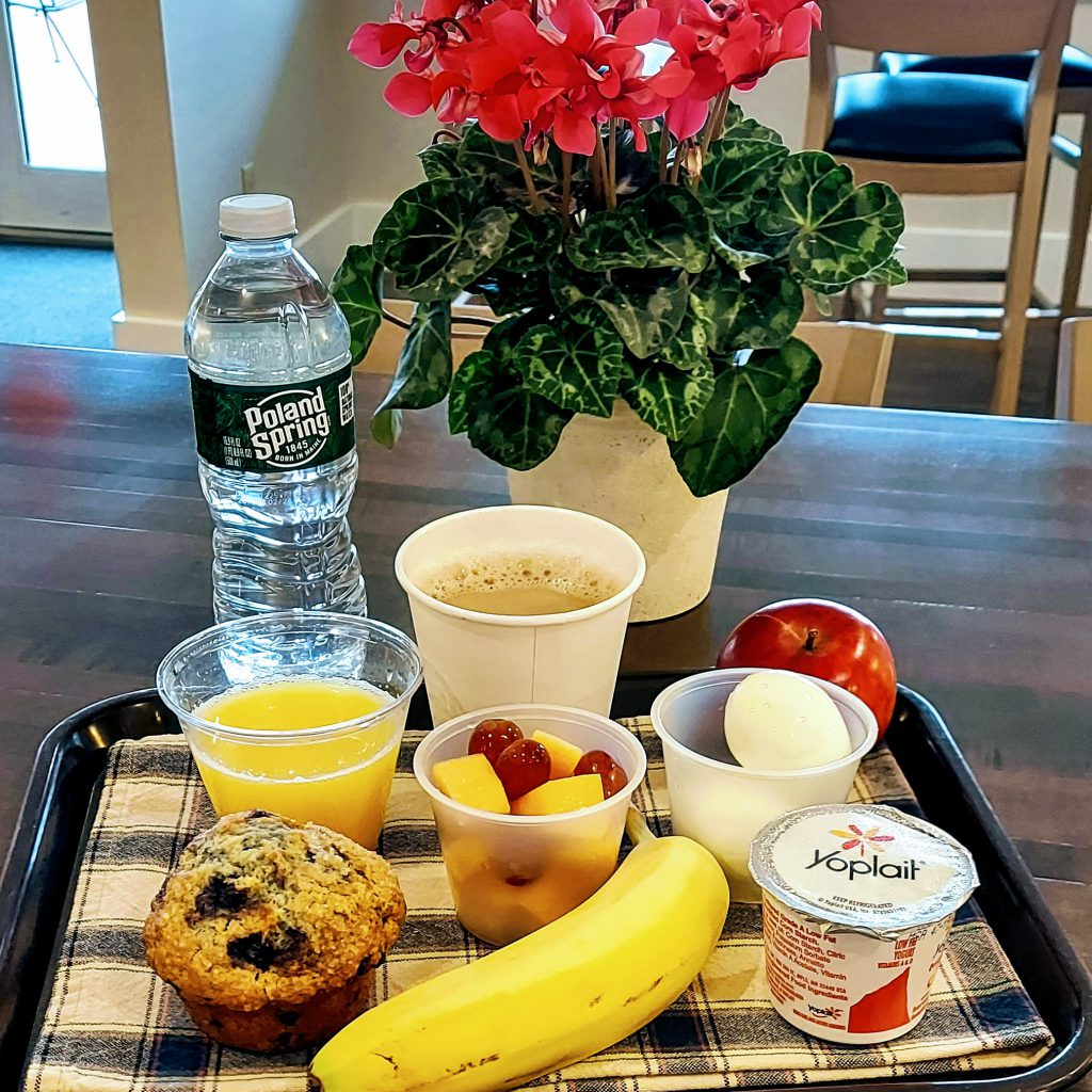 Example of breakfast items to choose from, including coffee, juice, bottled water, muffin, banana, apple, yogurt and hard-boiled egg